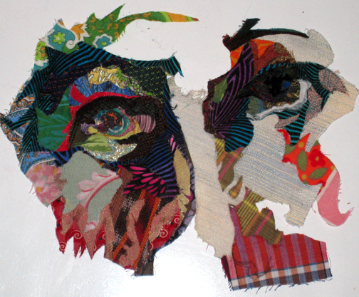 Incomplete face in fabric collage